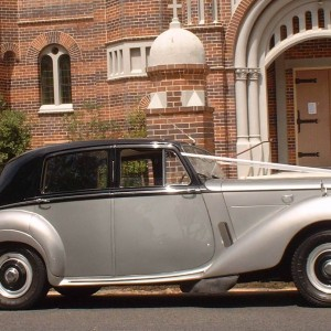 classic silver and black bentley wedding car