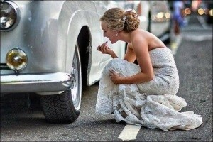 bride uses classic wedding car wheel hub as mirror
