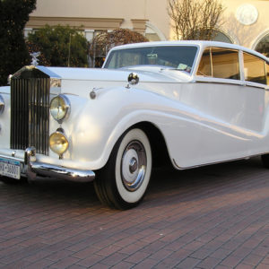 white vintage wedding car