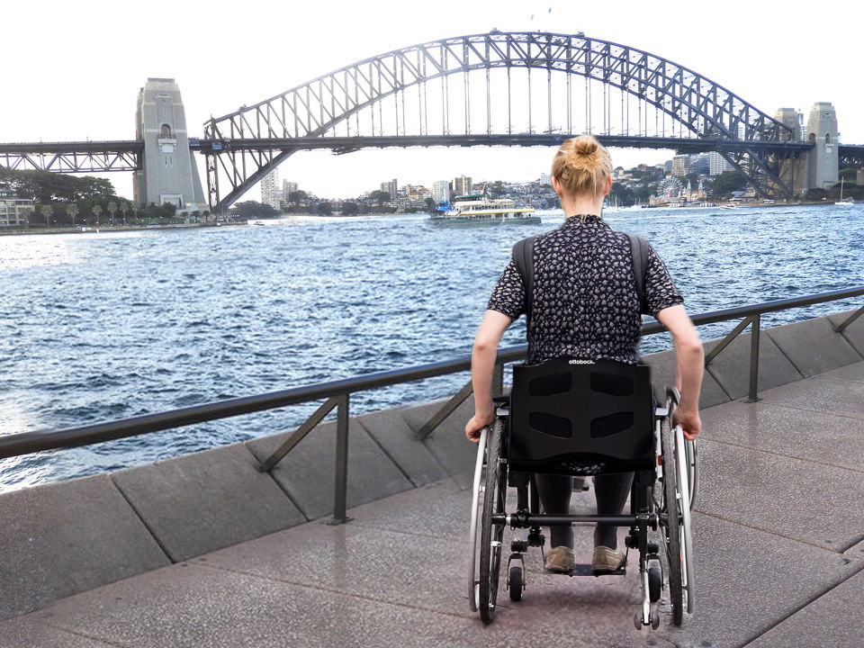 wheelchair traveller at sydney opera house and harbour bridge
